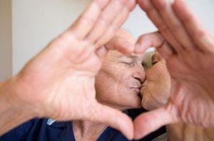 A senior couple kissing